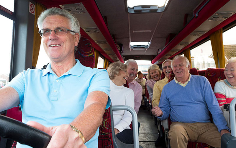 U3A members having a chuckle on a coach journey
