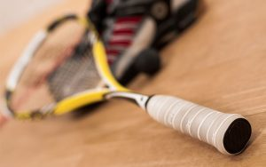Racketball racket, ball and shoes